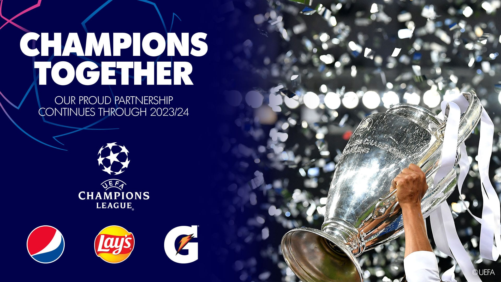 Imagen mostrando copa de la UEFA con logos patrocinadores